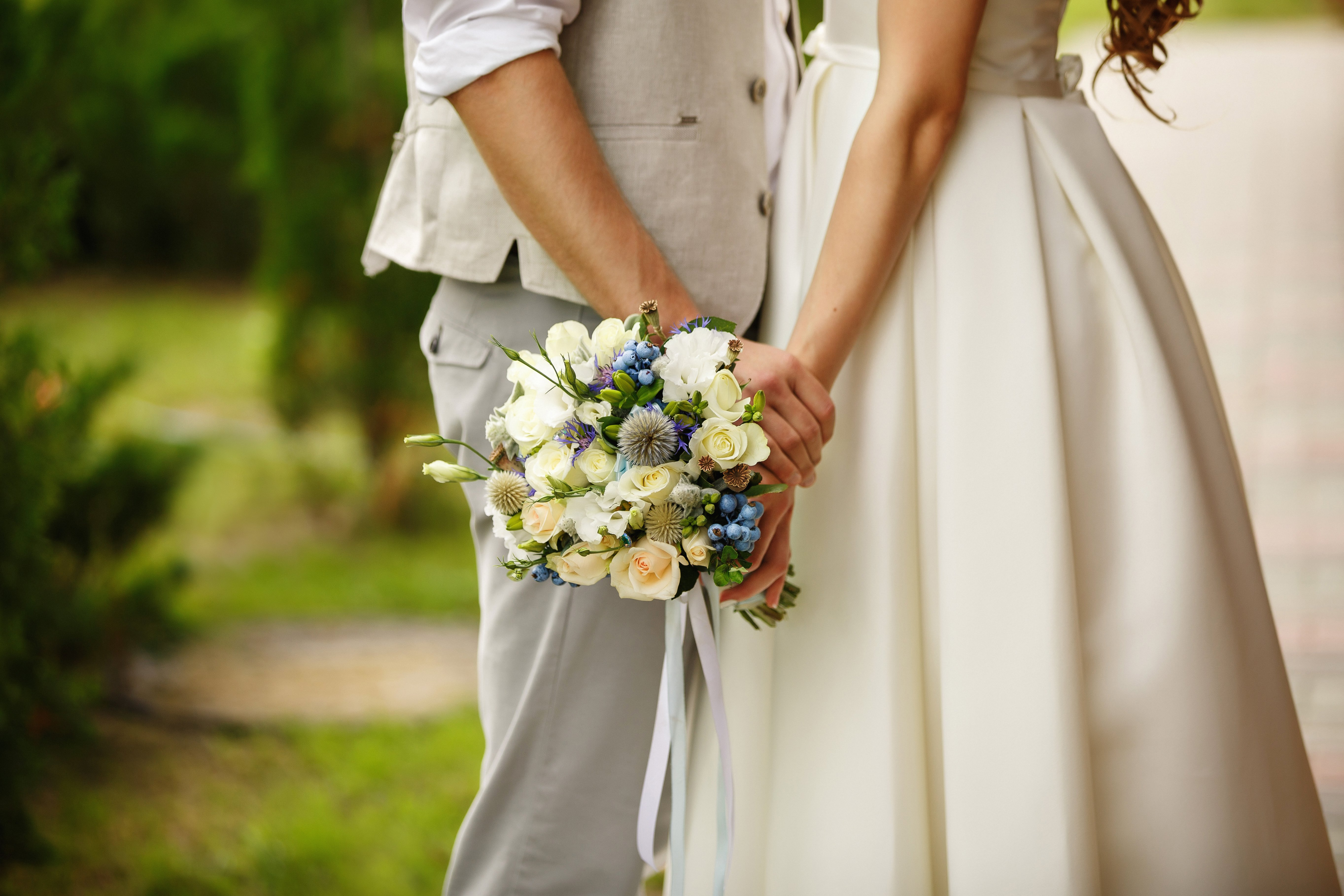 Wedding bouquet in hands of bride and groom in wedding day
